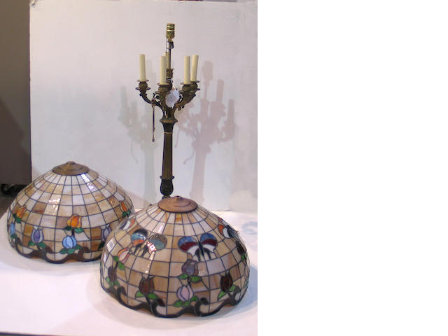 A Charles X style patinated and gilt bronze six light candelabra and a Neoclassical style lacquered brass table lamp
