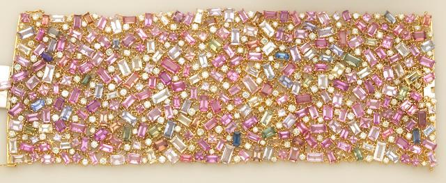 A multi-color sapphire, diamond and eighteen karat gold bracelet