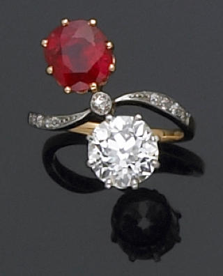 A diamond, ruby, and platinum-topped gold ring