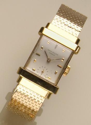 "A Patek Philippe, Geneve ""Top Hat"" gold bracelet wristwatch, reference #1450,"