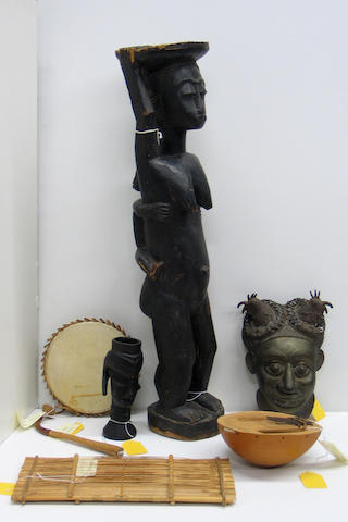 A group of African items: cup, bronze mask, musical instruments (3), female figure