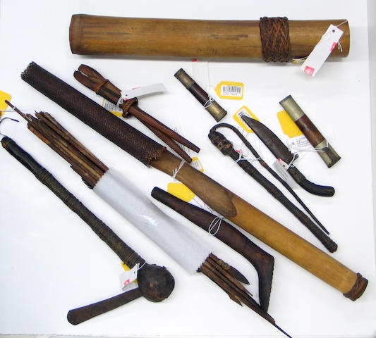 A collection of ethnographic items: arrows, quivers (3), staff, pliers, shoe last, knife scabbard (2), knife with scabbard, axe, quirt