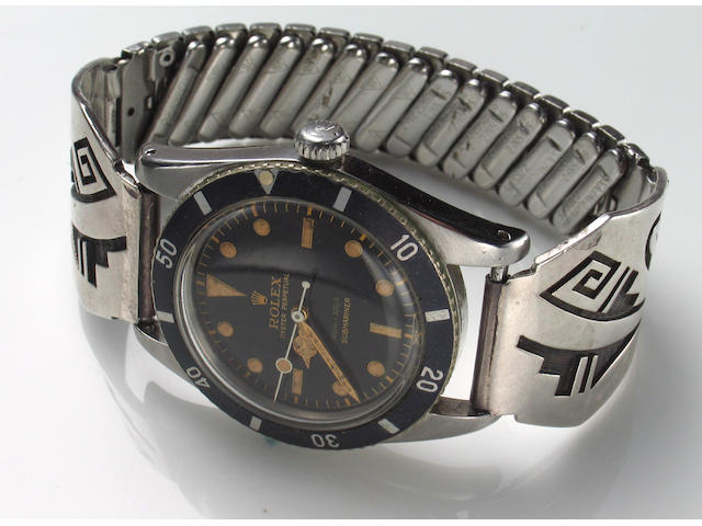 "A Rolex, Geneve ""Submariner"" stainless steel, self-winding wristwatch, with white metal stretch band,"
