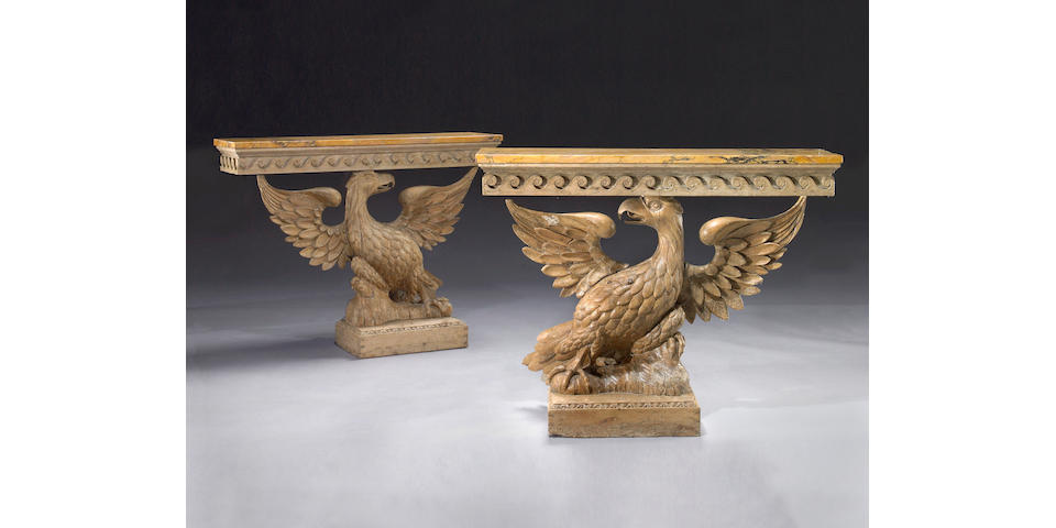 A pair of carved pine console tables