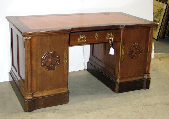 A Continental walnut brass mounted pedestal desk