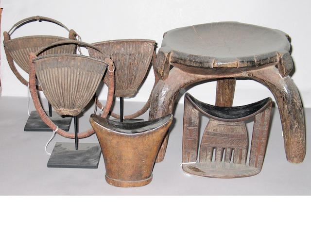 Six African items: Oromo headrests (2); three-legged stool;  Kirdi cache-sexes (3)