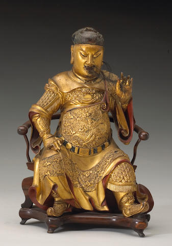 A polychrome lacquered wood figure of Guandi