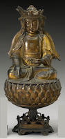A gilt bronze two-section seated Sakyamuni, Ming Dynasty