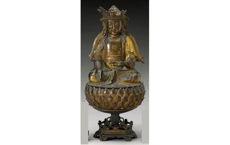 A gilt bronze two-section seated Shakyamuni Ming Dynasty