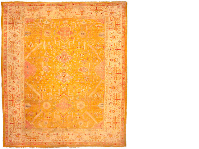 An Oushak carpet West Anatolia, Size approximately 14ft 6in x 12ft 7in