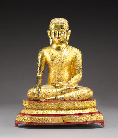 A large Thai gilt lacquered bronze seated figure of Buddha on a raised plinth