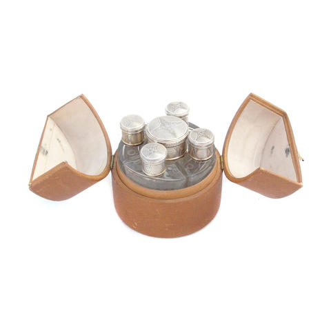 A leather cased set of silver and glass scent bottles