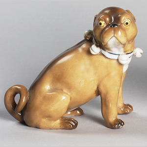 A Dresden model of a seated Pug, 5 in. (12.5 cm.)