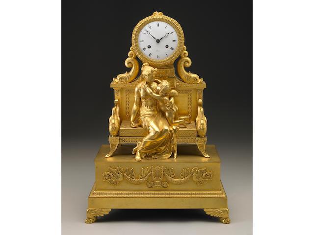 An Empire gilt bronze mantel clock