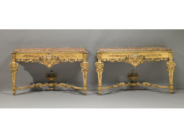 A pair of Italian Baroque style giltwood marble top console tables