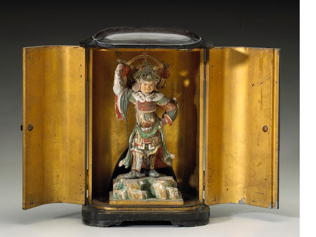 A Japanese lacquered wood stand with Guardian
