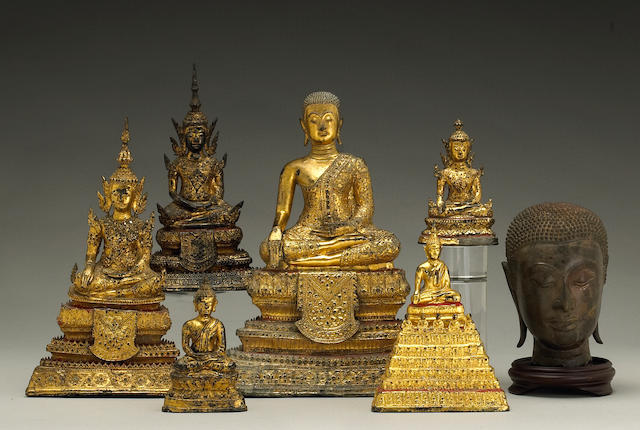A group of Thai bronze Buddhas
