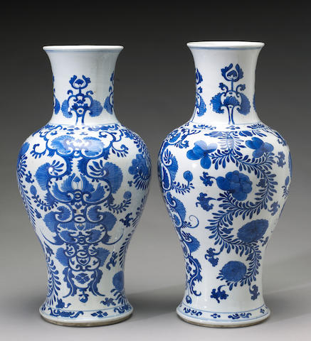 A pair of blue and white porcelain ovoid vases with scrolling decoration, Kangxi Period, one with ne