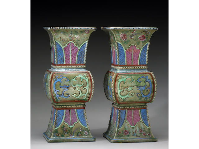 A pair of famille rose enameled pottery vases