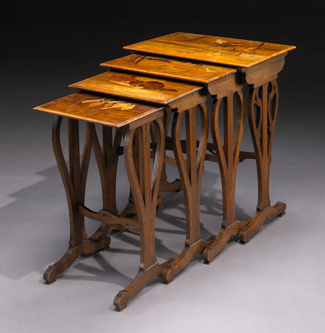 A set of four Gallé  marquetry inlaid nesting tables