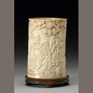 An ivory brush pot with decoration of sages, 19th Century, age cracks, bottom replaces with faux ivo