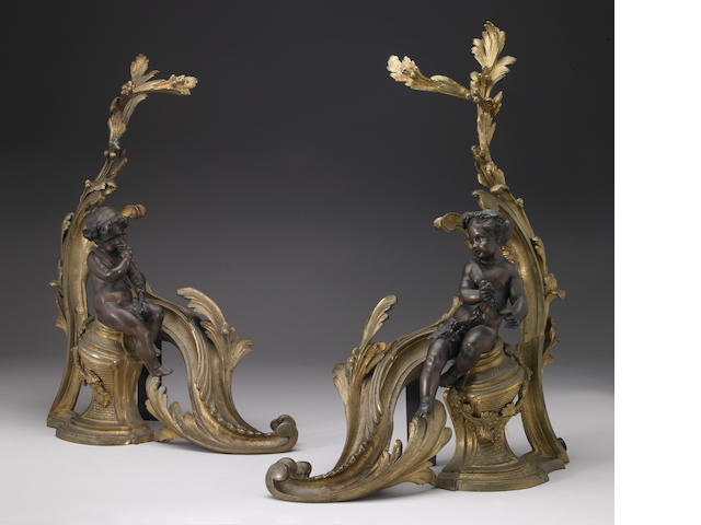 A pair of Louis XV style gilt and patinated bronze chenets