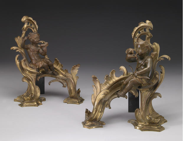 A pair of Louis XV style gilt bronze chenets