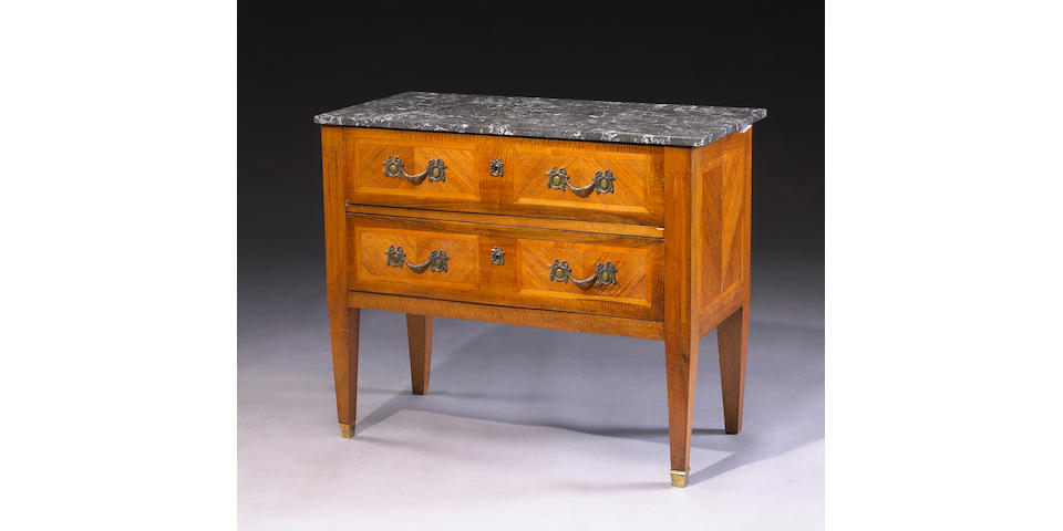 A Continental Neoclassical inlaid walnut commode