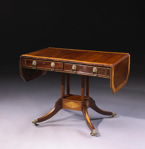 A Regency mahogany and bird's eye maple crossbanded sofa table