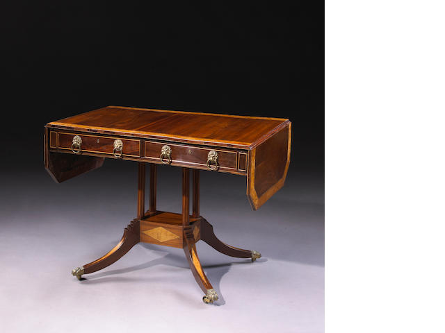 A Regency mahogany and birds eye maple crossbanded sofa table
