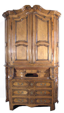 An Italian Neoclassical style walnut secretary cabinet