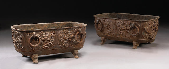 A pair of Continental cast iron cisterns