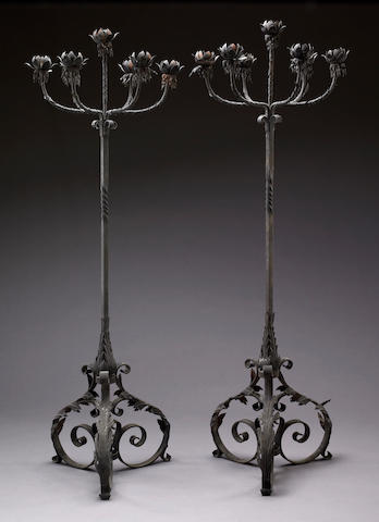 A pair of Renaissance style patinated tôle and iron torchères