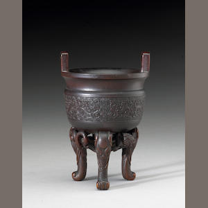 A fine and rare rhinoceros horn libation vessel of ding shape, 17th/18th Century