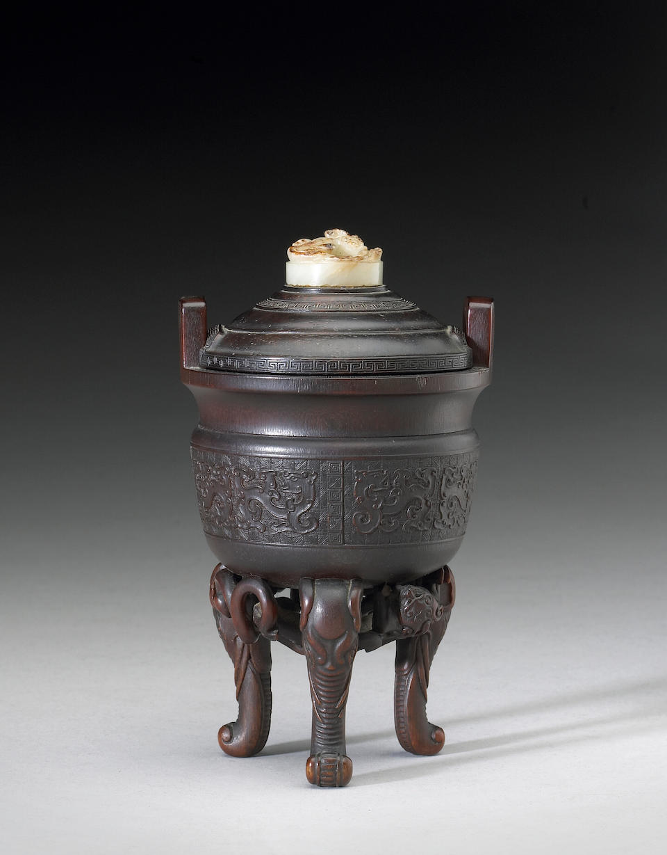 A fine and rare rhinoceros horn libation vessel of ding shape 17th/18th Century