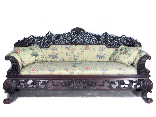 An Anglo Indian carved hardwood couch with Salamandre upholstery
