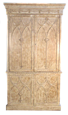A Gothic style faux grained cabinet