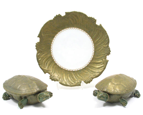 A set of eight Limoges porcelain plates with turtle bowls with lids