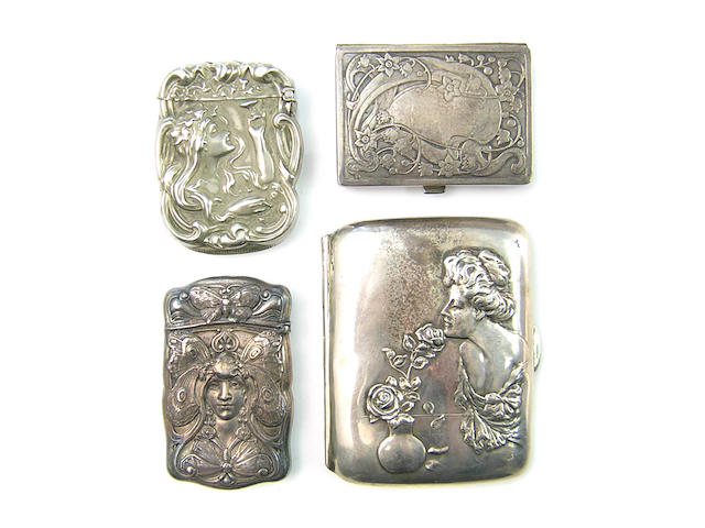 A collection of Art Nouveau silver and metal cigarette boxes and match safes