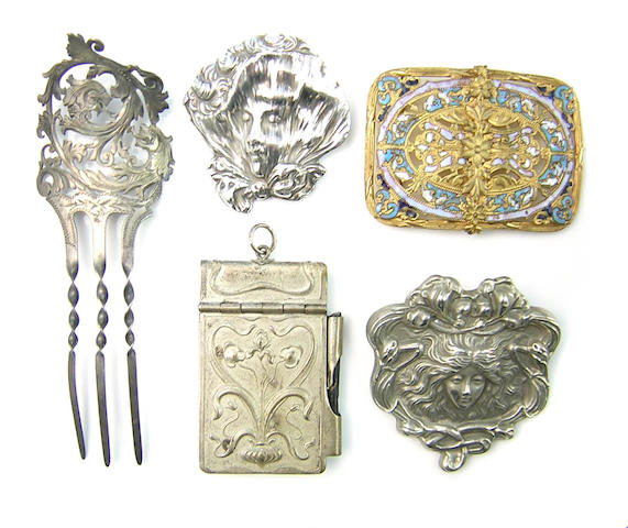 A collection of Art Nouveau silver and metal jewelry, belts, boxes, and other misc items.
