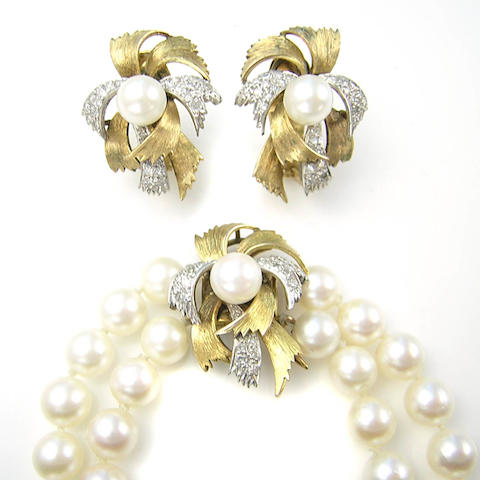 A cultured pearl, diamond and 14 karat gold necklace and earrings set