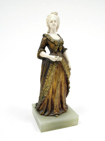 A gilt bronze and ivory figure of an 18th century lady