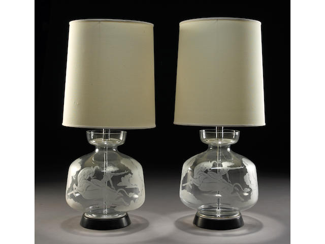 A pair of engraved glass and metal table lamps