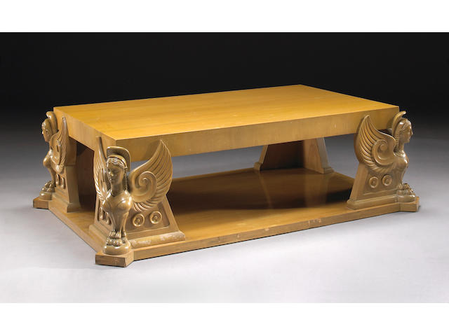 A T.H. Robsjohn-Gibbings carved harewood winged-sphinx coffee table