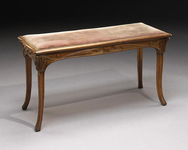 An Edouard Colonna carved wood bench