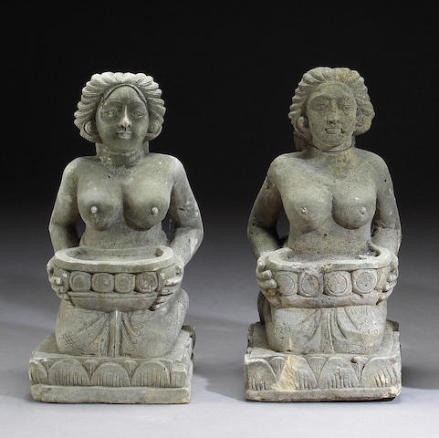 A pair of Southeast Asian carved stone female figures