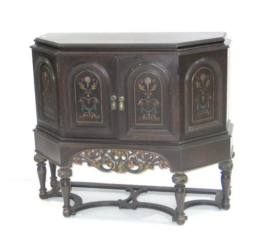 A Barqoue style polychrome decorated walnut cabinet