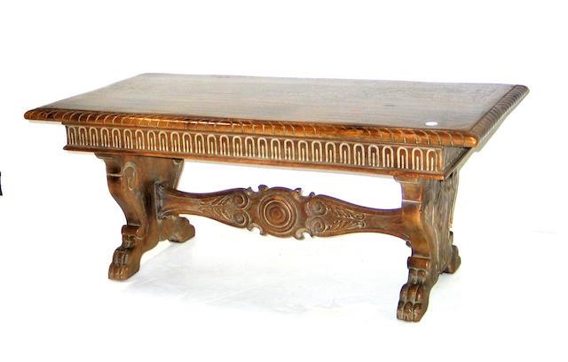 A Baroque style oak coffee table