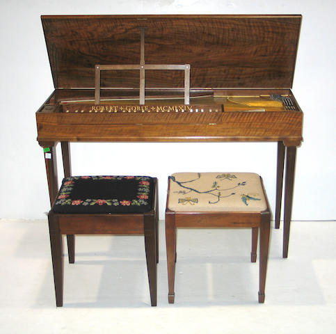 A walnut harpsichord together with two needlepoint upholstered piano stools and a pair of Louis XVI style gilt metal brackets