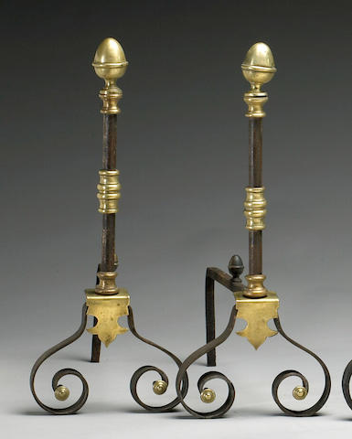 A pair of Louis XIII style brass and cast iron chenets
